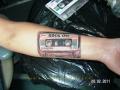 татуировка в виде кассеты